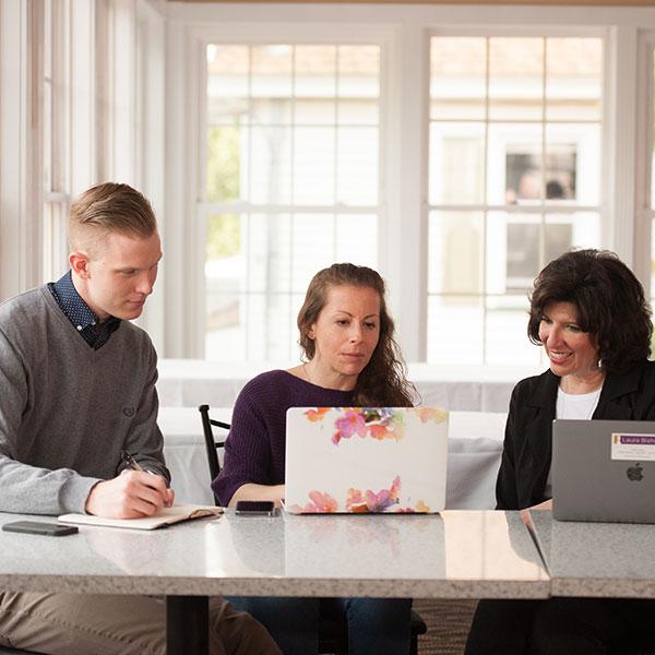 Ben, LauBen, Lauren and Sheri work on a social media plan for a clientren and Sheri work on a social media plan for a client.)