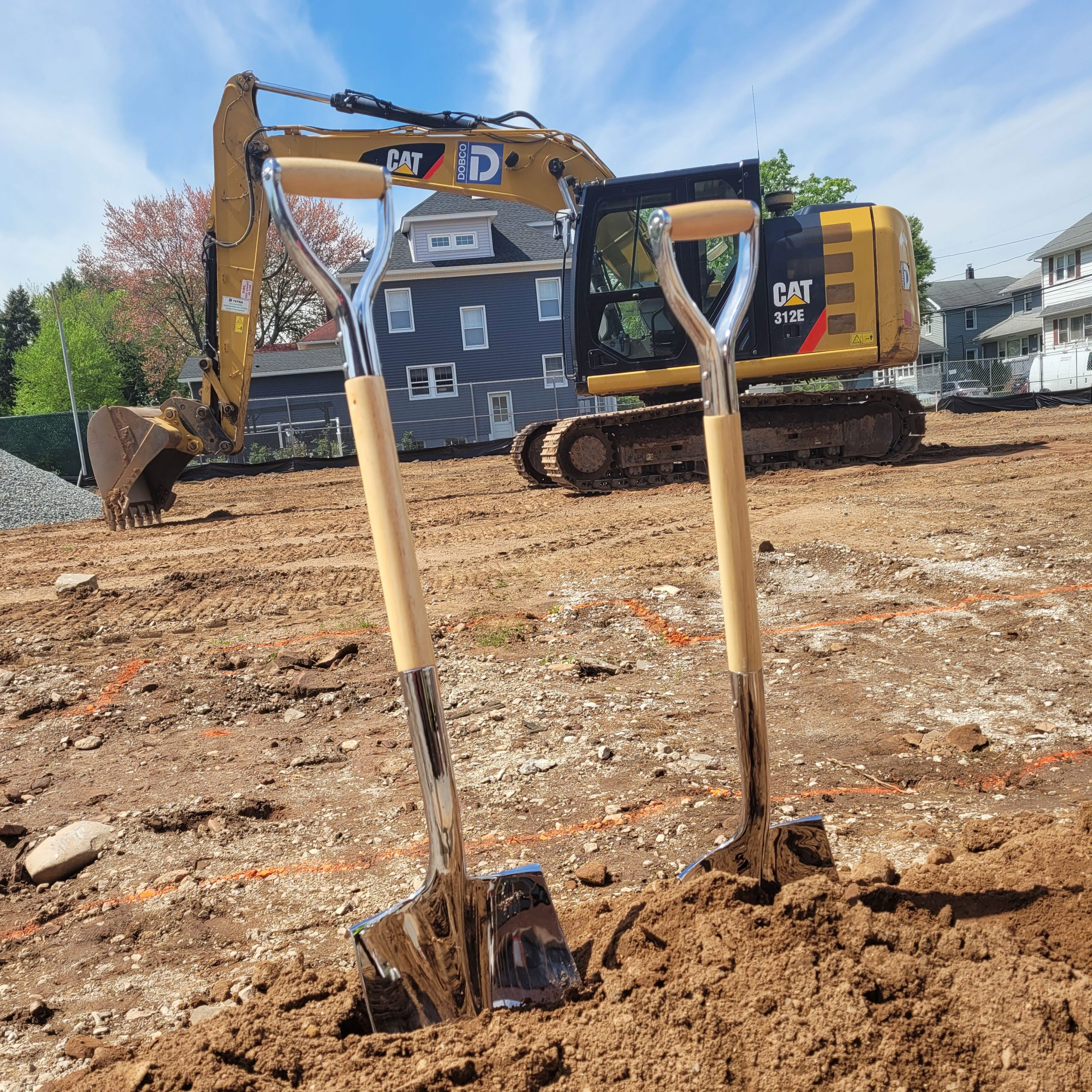 Groundbreaking at a new school shovels in dirt