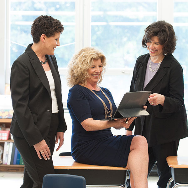 Renee, Laura and Sheri review details of a bond referendum communications campaign