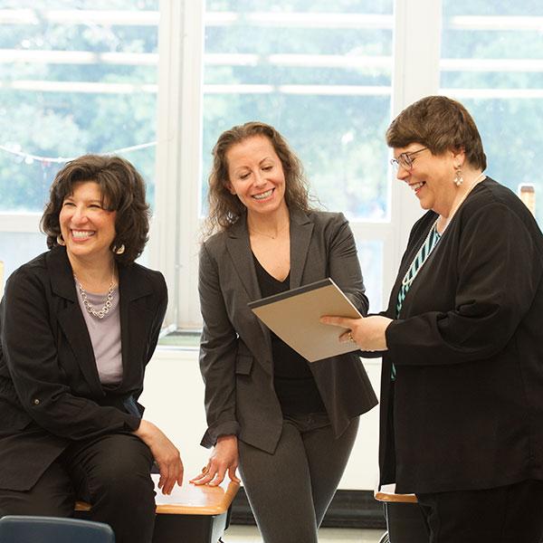 Sheri, Lauren and Kathleen work on a school PR campaign